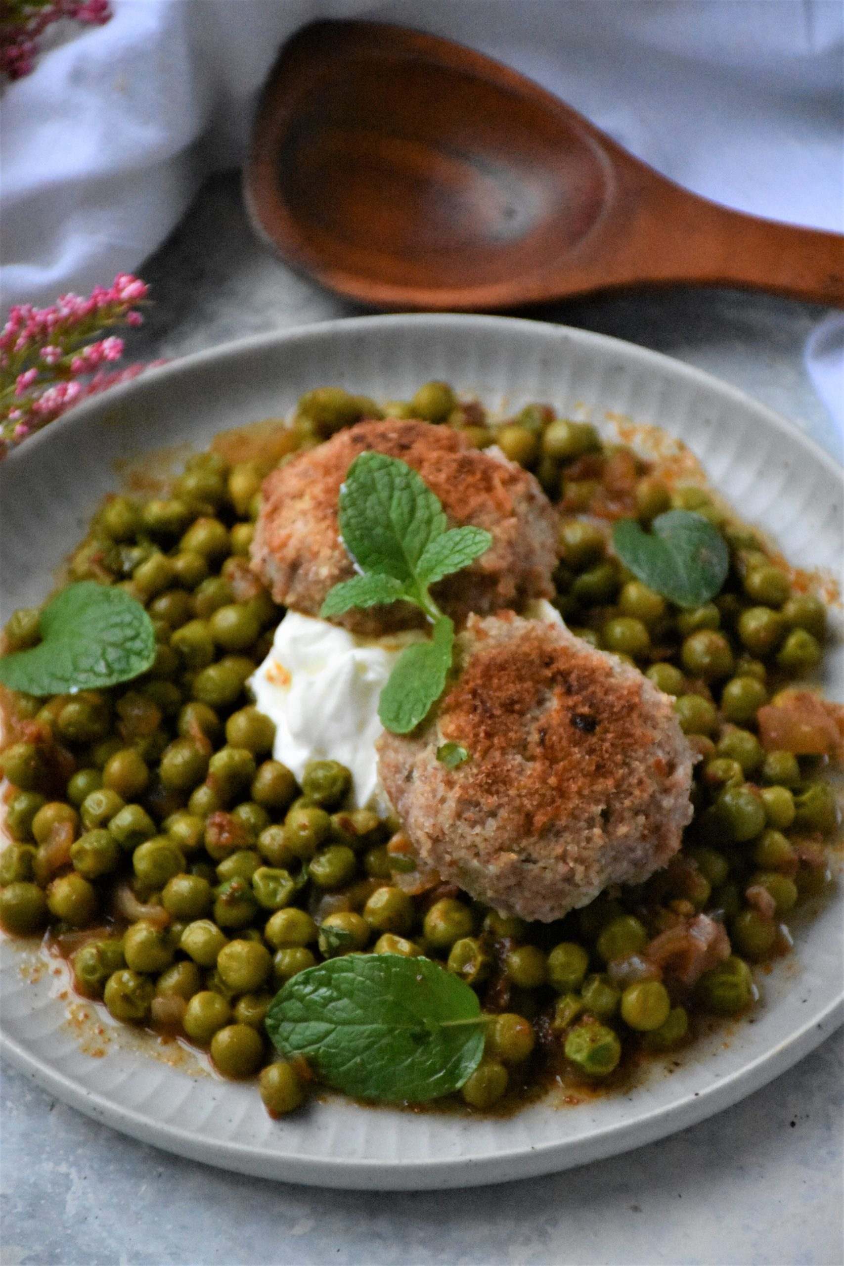 peas and meatballs on a plate