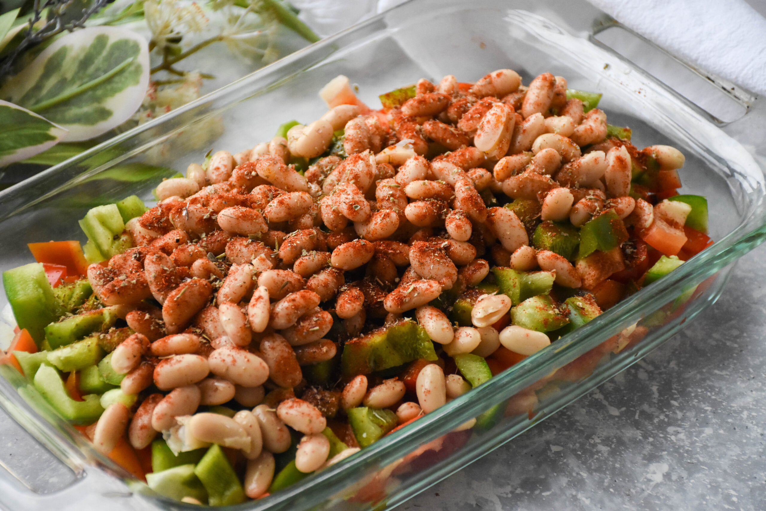 cannellini beans and vegetables in a casserole dish